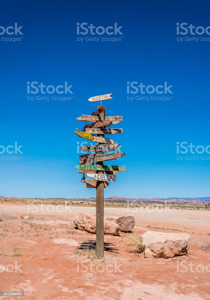 Ancient road sign in the Wild West stock photo