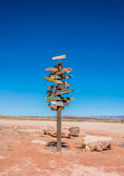 ancient road sign in the wild west - west direction stock pictures, royalty-free photos & images