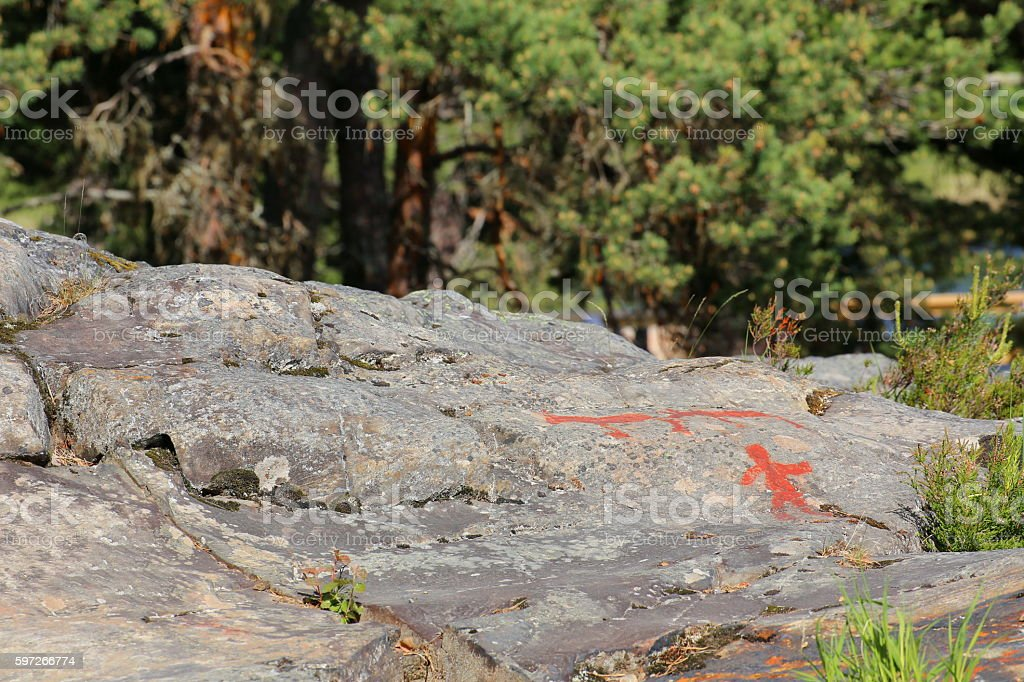 Ancient rock paintings in Naesaaker ins Sweden royalty-free stock photo