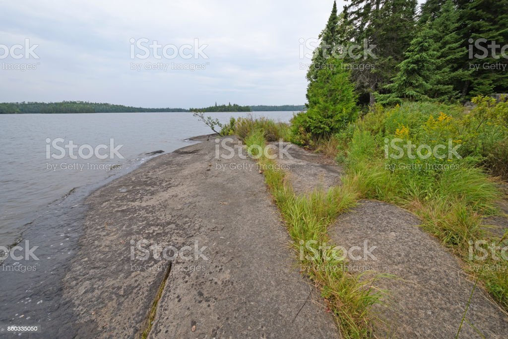 Ancient Rocks on a Wilderness Lake Shore stock photo