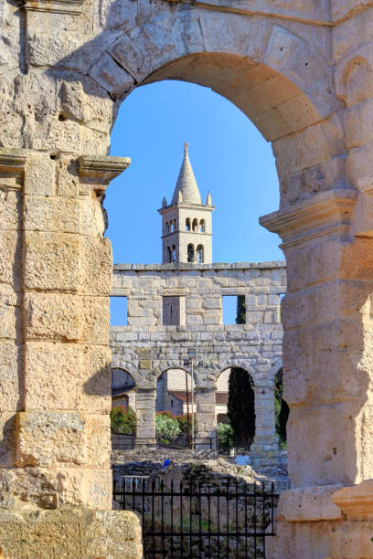Ancient Roman Amphitheater and Church Bell Tower in Pula, Istria, Croatia, Europe stock photo
