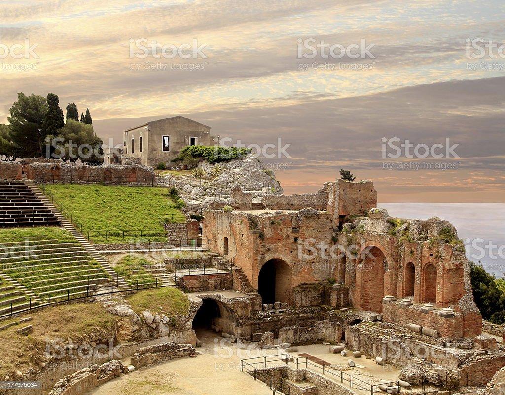 Ancient Roman Amphitheater at Sunset in Taormina Sicily stock photo