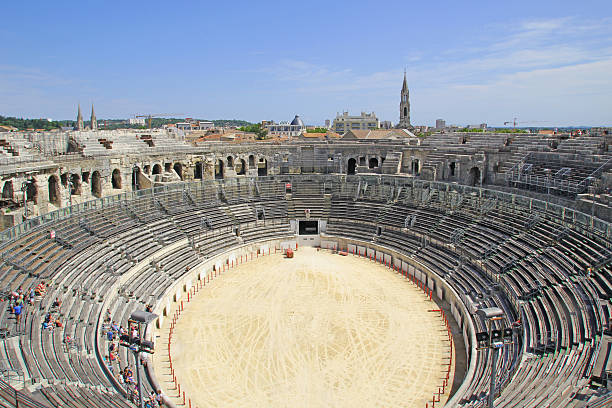 Ancient roman Amphitheater in Nimes, France Roman Amphitheater in Nimes, France amphitheater stock pictures, royalty-free photos & images