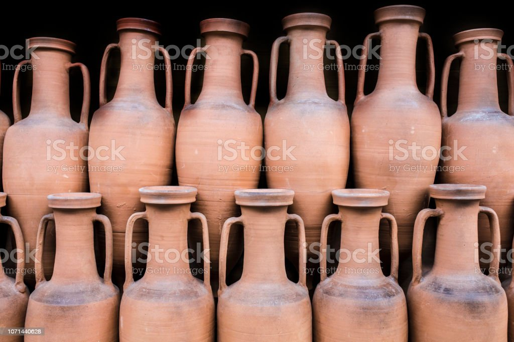 Ancient roman amphorae stored at hold ship as ancient times trade stock photo
