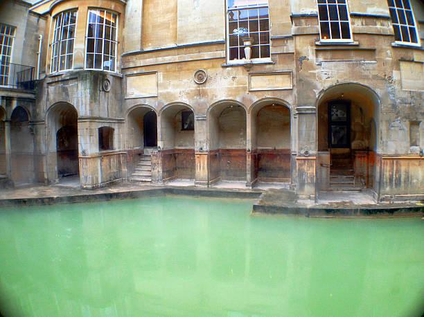Ancient Roman Baths, Bath, England Bath, England - May 2, 2016: The actual hot spring of the Roman Bath roman baths england stock pictures, royalty-free photos & images