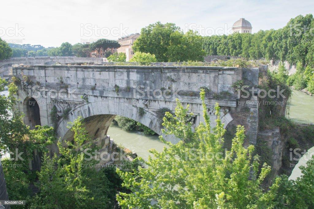 Ancient Roman bridge in Rome stock photo