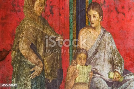 860524946 istock photo Ancient Roman fresco in Pompeii showing a detail of the mystery cult of Dionysus 650486692