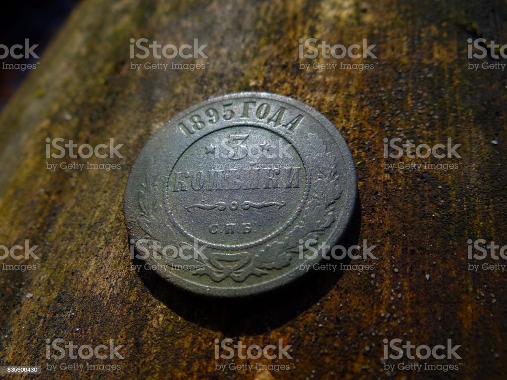 Ancient royal coin on wood stock photo