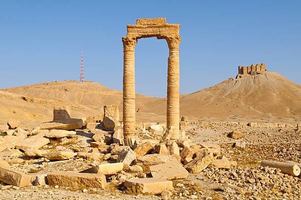 Ancient and modern towers in Palmyra, Syria Ancient ruins and a modern communication tower in Palmyra, Syria. In the foreground are columns and rubble from the late Roman period or shortly thereafter; on the hill on the right is a 17th century fort; on the hill on the left is a modern communication tower. greco roman style stock pictures, royalty-free photos & images