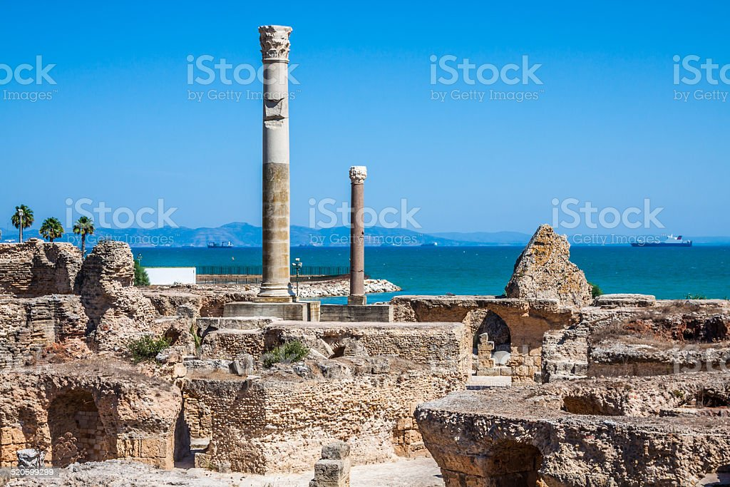 Ancient ruins at Carthage, Tunisia with the Mediterranean Sea in stock photo