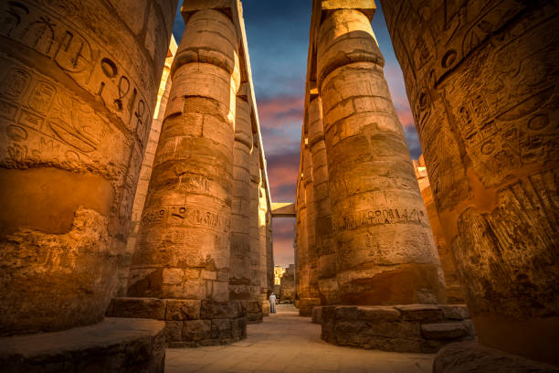Ancient ruins of Karnak temple with colorful sky, Egypt stock photo