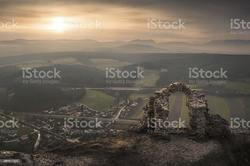Ancient Ruins with Mountains and Village in Background stock photo