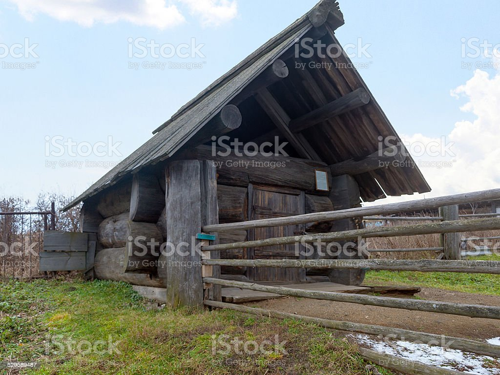 Ancient Russian bath, composed of three logs stock photo
