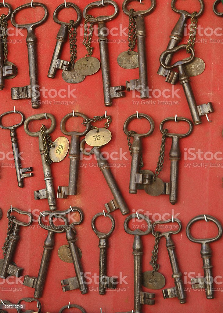 ancient rusty iron keys in an antique shop stock photo