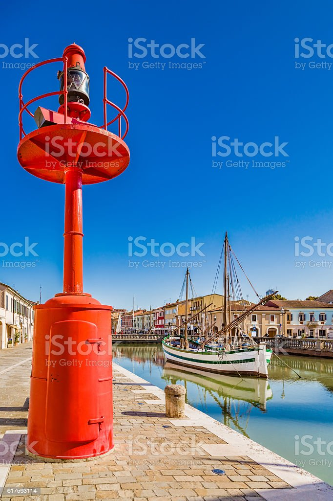 ancient sailboats and lamp on Italian Canal Port stock photo