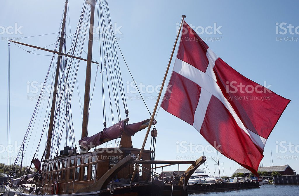 Ancient sailing ship with danish flag royalty-free stock photo