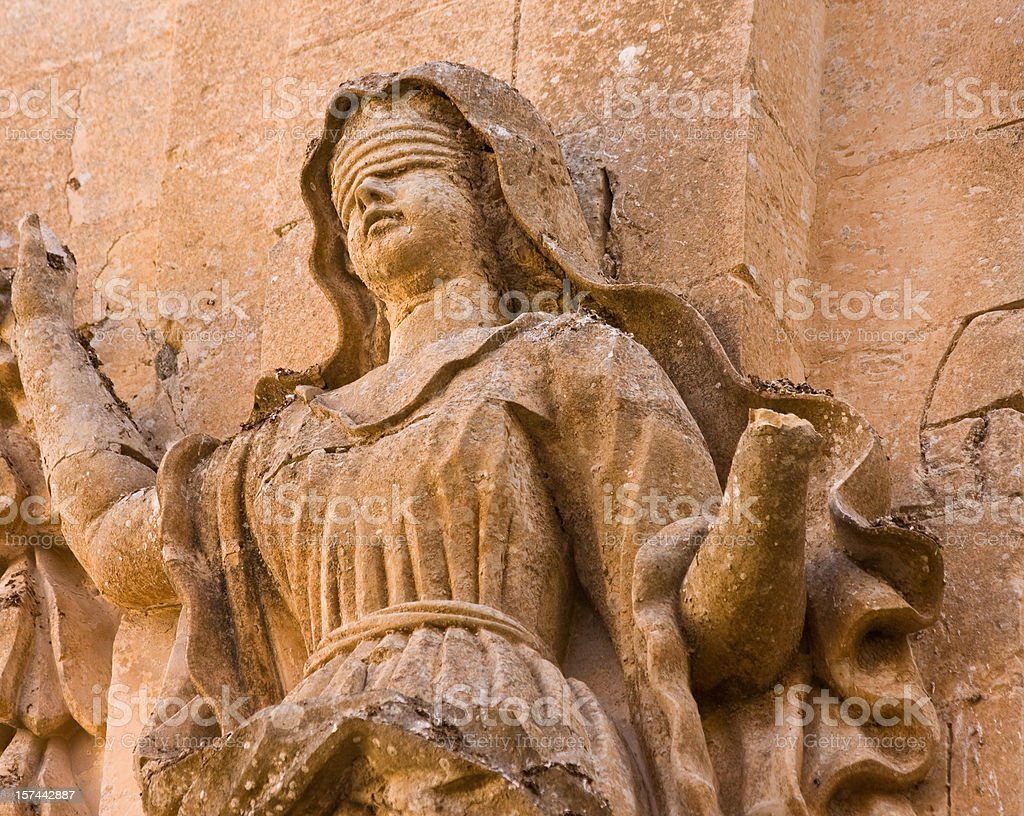 ancient sandstone Lady Justice stock photo