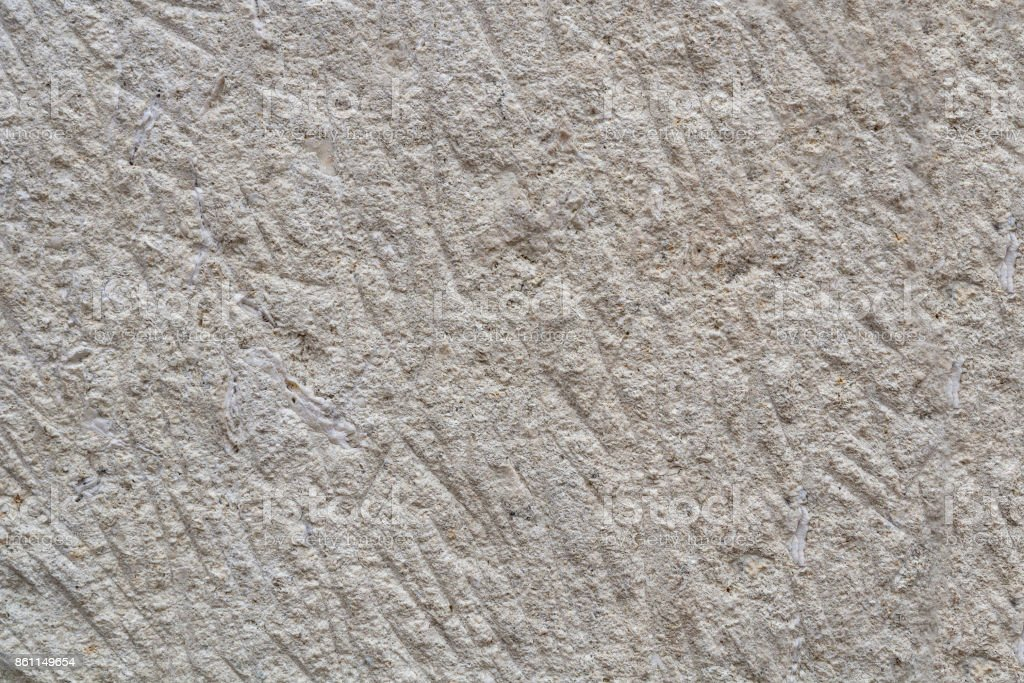 Ancient sandy rough stone. Textural background. Close-up. stock photo