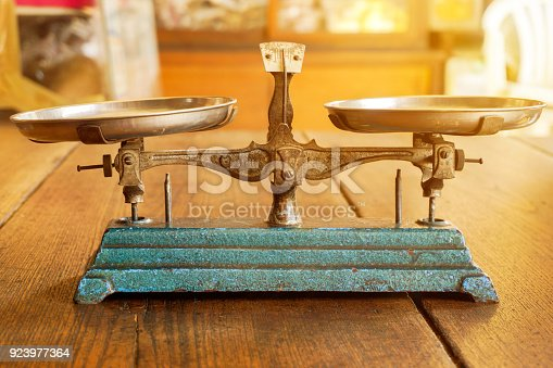 istock Ancient scales with the weight balance 923977364