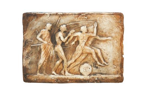 Ancient greek jug on green grass