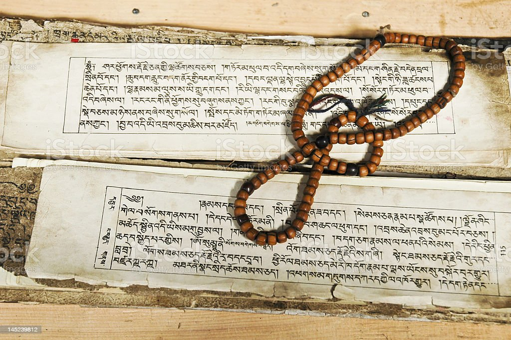 Ancient script and prayer beads stock photo