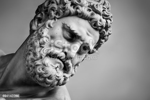 istock Ancient sculpture of Hercules and Nessus. Florence, Italy. Head close-up 694142286