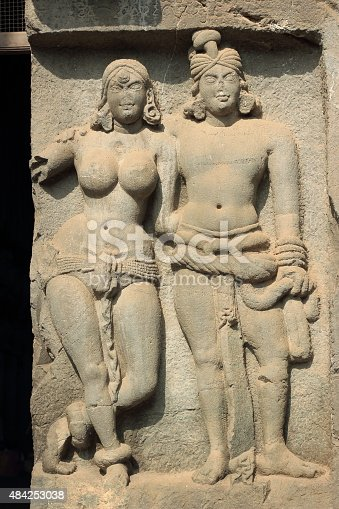 istock Ancient sculpture of Indian man and woman in Karla caves 484253038
