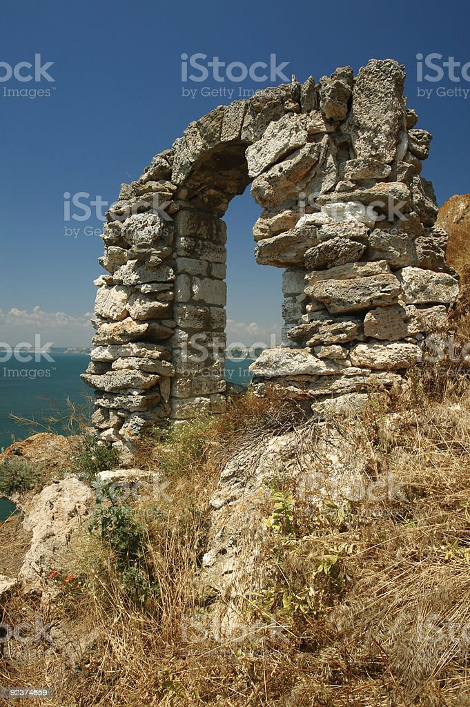 Ancient sea-side stone arch royalty-free stock photo