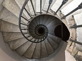 Spiral staircase inside an abandoned home.