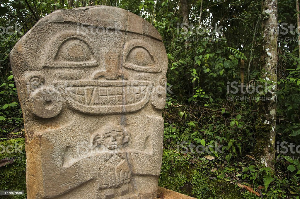 Ancient Statue Holding a Child stock photo