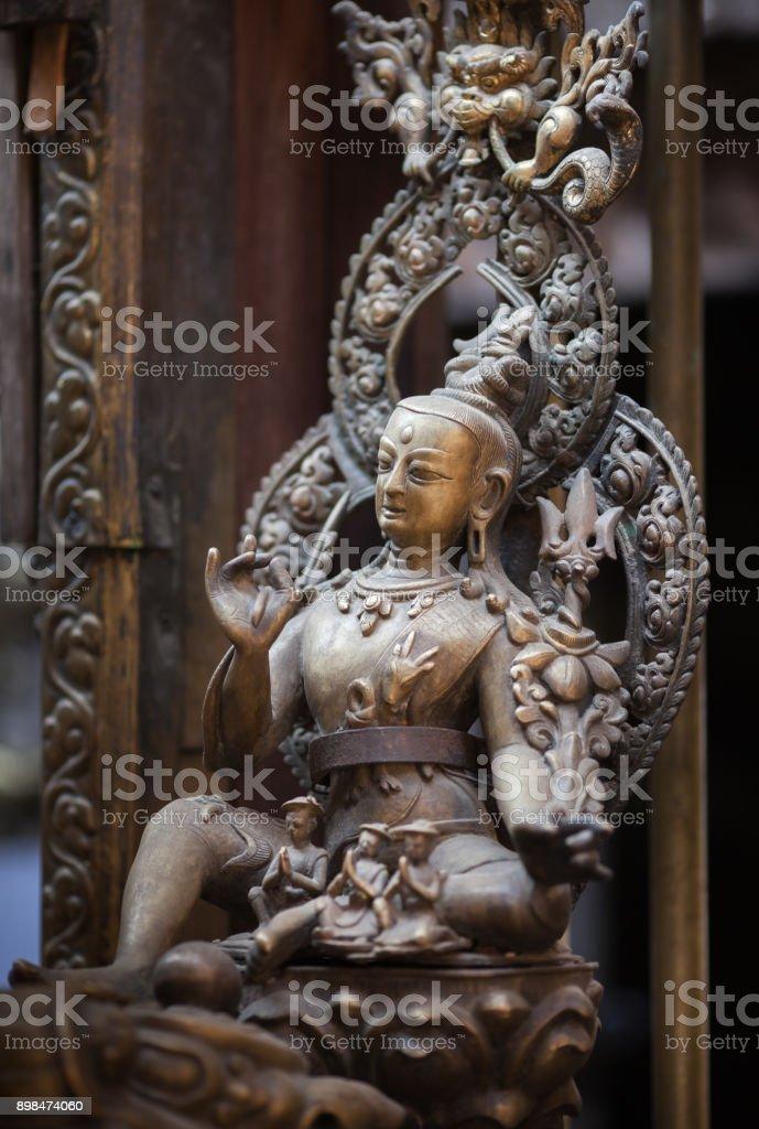Ancient statue of a bodhisattva of Avalokiteshvara. stock photo