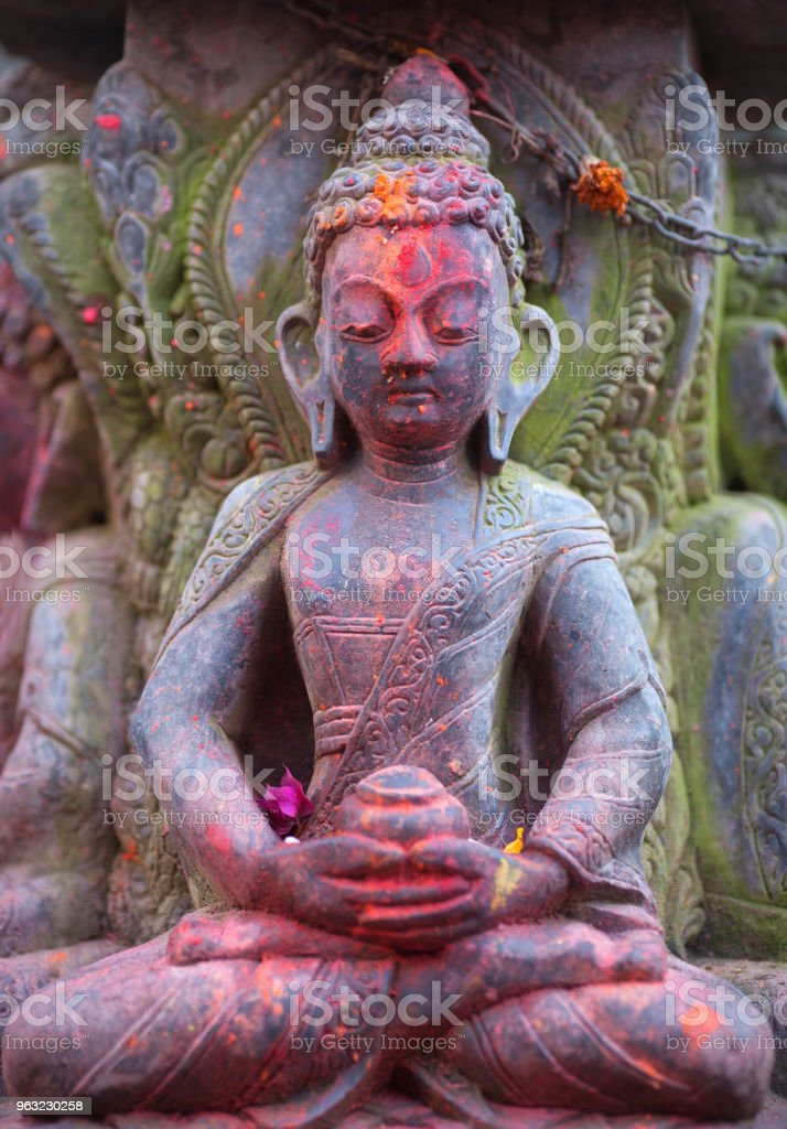 Ancient statue of Buddha at the temple in Bhaktapur, Nepal stock photo