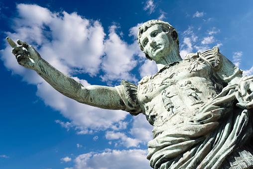 Ancient statue of Julius Caesar in Italy isolated against blue Sky