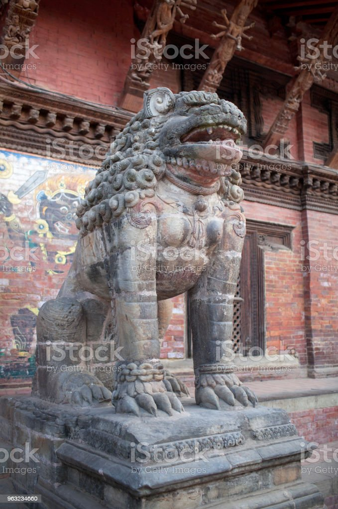 Ancient statue of Lion at Durbar Square in Patan, Nepal stock photo