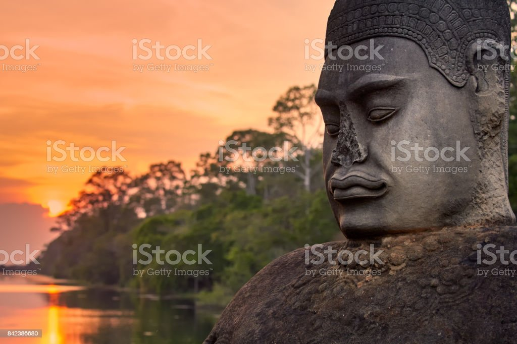 Ancient statues outside South Gate of Angkor Thom in Siem Reap, Cambodia stock photo