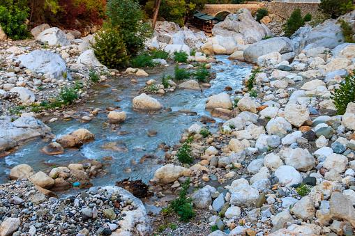 Ancient stone bridge across a mountain river in Kesme Bogaz canyon, Antalya province in Turkey