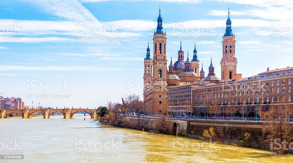 Ancient stone bridge and Cathedral from Ebro river. Zaragoza, Ar stock photo