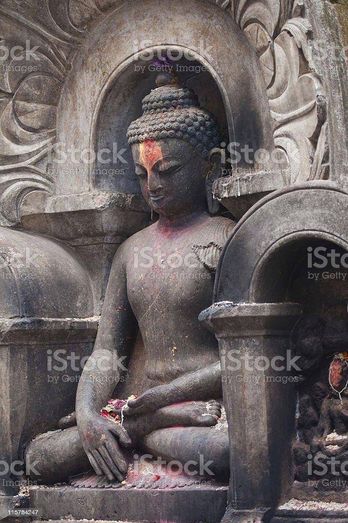 Ancient stone Buddha Swaybudnath Nepal stock photo