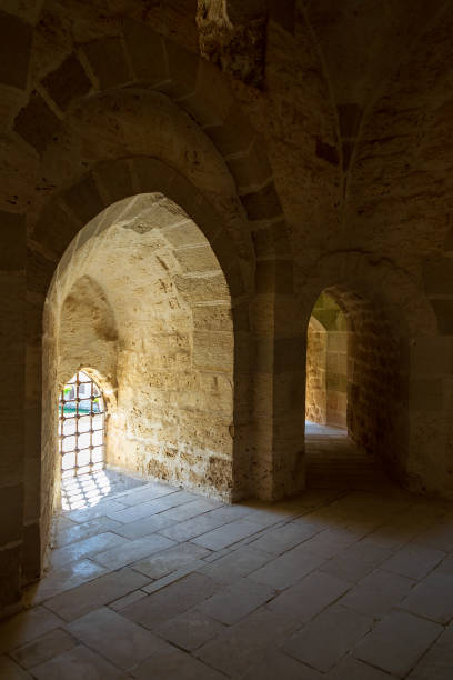Ancient stone building with bright sunlight shining through arches stock photo