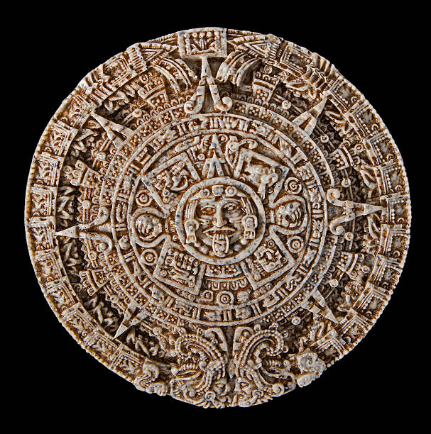 Ancient stone caledar cut out of marble stone an isolated replica of the famous aztec / myan calendar that supposedly showed the world ending in 2012 2012 stock pictures, royalty-free photos & images
