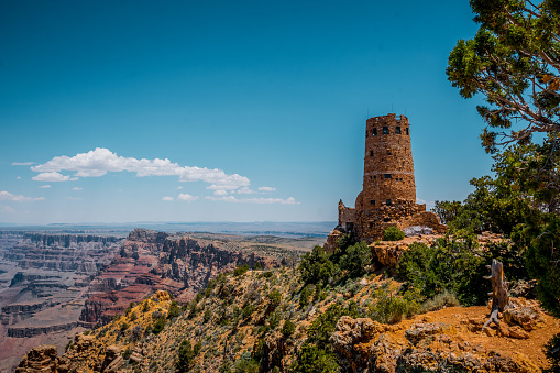 ancient picturesque stone tower on the edge of a cliff in the Grand Canyon. Survey area. Deserted Viev. Arizona Tourist Attractions