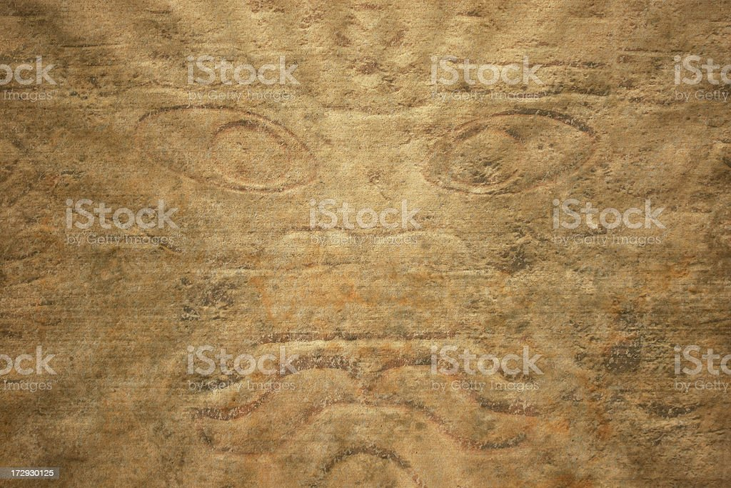 ancient stone face with burst edges royalty-free stock photo