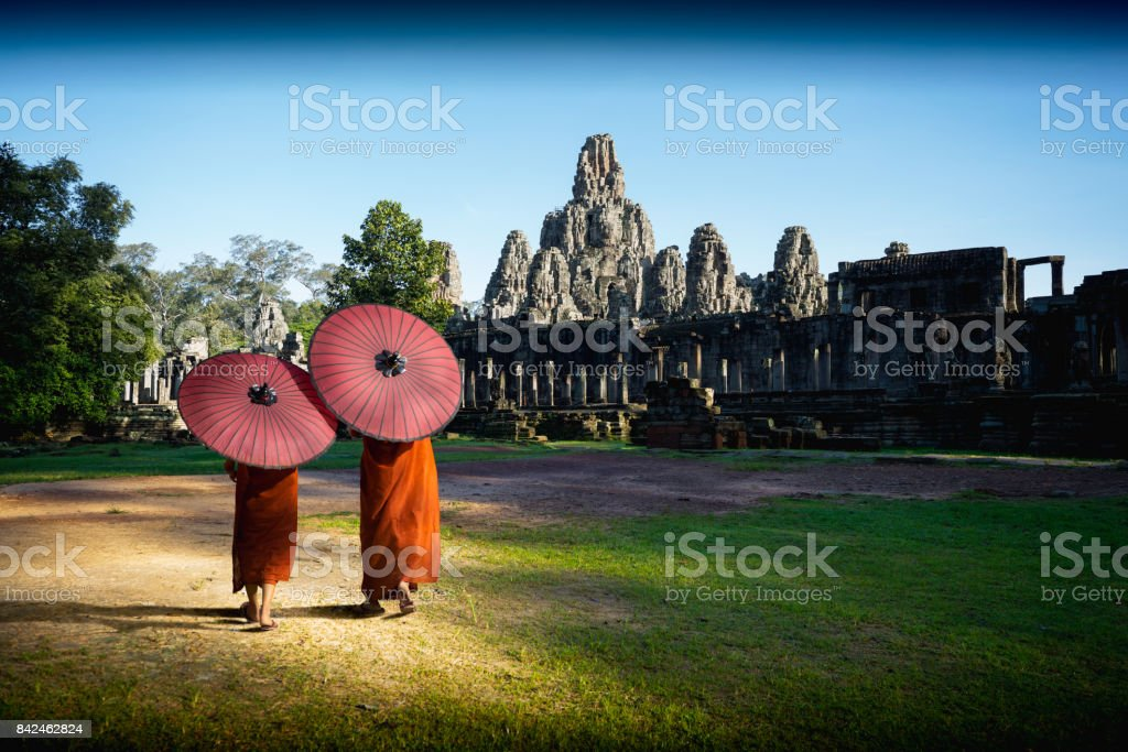 Ancient stone faces of Bayon temple stock photo