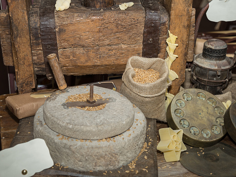 istock Ancient Stone Mill: Manual Grinder Wheel with Crank and Wooden Press for Pasta 1090510894
