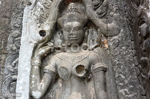 Ancient stone sculpture of the dancer Apsara on the wall of the temple of Angkor Wat, Cambodia, Southeast Asia