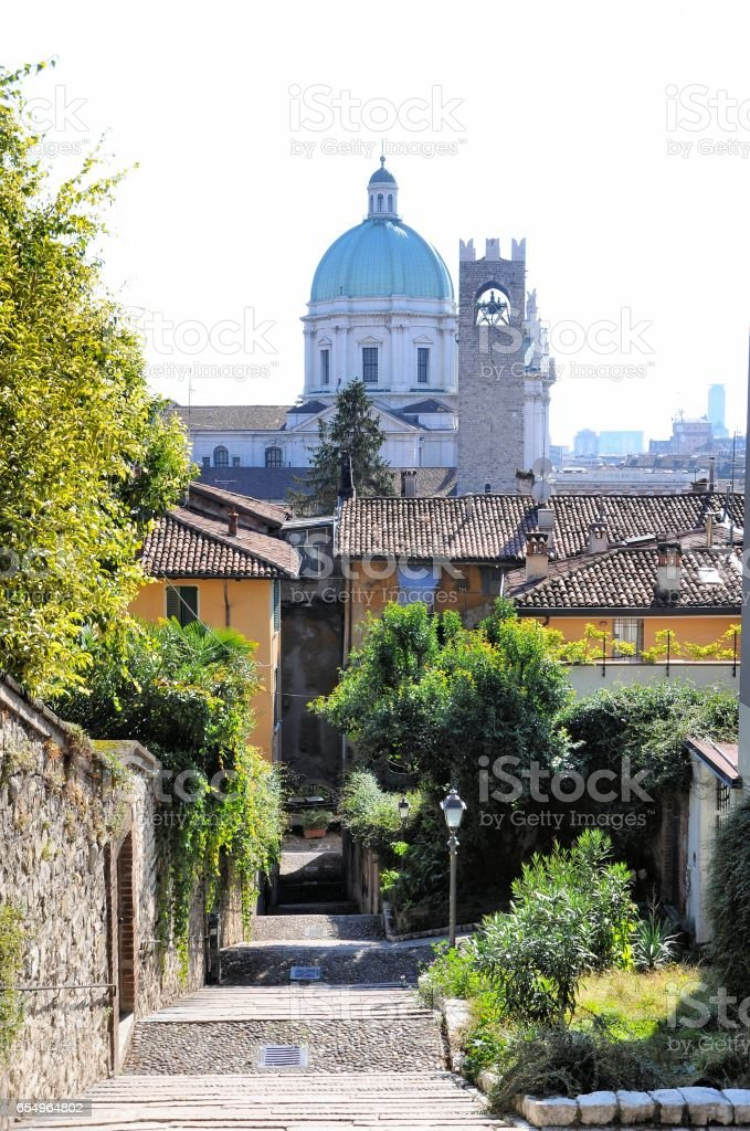Ancient stone staircase and cityscape with baroque dome and medieval tower. - foto stock