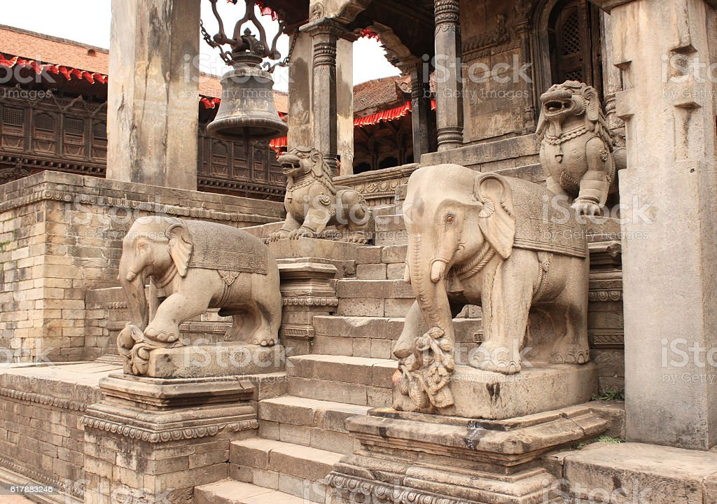 Ancient stone statue of elephants and dogs on steps, Bhaktapur stock photo
