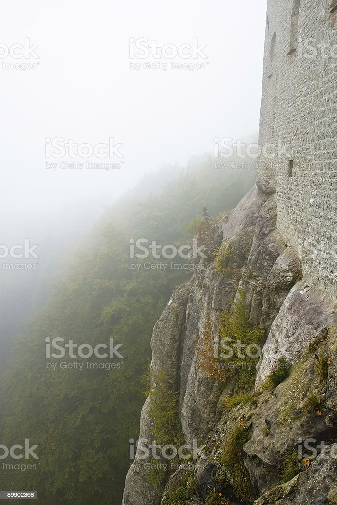 Ancient stone wall on a high cliff royalty-free stock photo