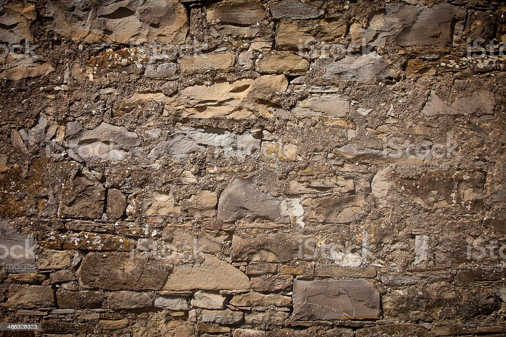 Ancient stone wall texture wil mold stock photo