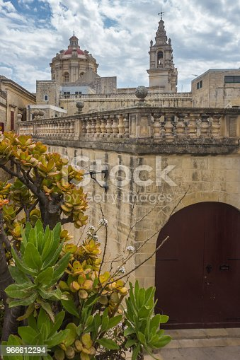 istock Ancient street in Mdina with a view on St. Paul's Cathedral, Valletta, Malta 966612294